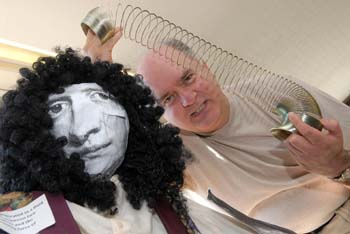 Director of Studies for the Universe as an Art Dr Chris Bowdery with a model of Sir Isaac Newton