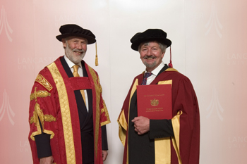 Dr Mike Dexter receiving his honorary degree from Sir Christian Bonington