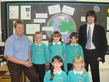 Ghyllside School Class Teacher Matt Towe (left) with Lancaster University student Alex Bartlett (far right) and year four pupils at Ghyllside School