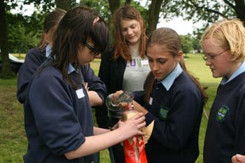 Photo caption: Student volunteer Nicola Bennett helps pupils from Our Ladies' Catholic College in Lancaster build a rocket: photo courtesy of Abi Williams