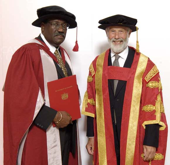 Clive Lloyd (left) receives honorary degree from Chancellor Sir Chris Bonnington