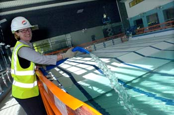 Director of Sport Kim Montgomery filling the new pool: photo courtesy of Nigel Slater