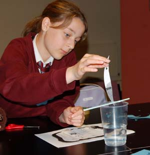 A Skerton High School pupil examines the evidence