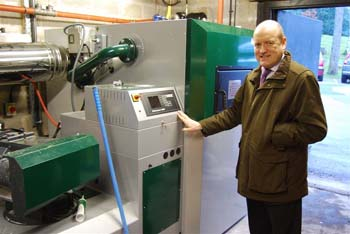 Nick Lancaster with the new biomass burner