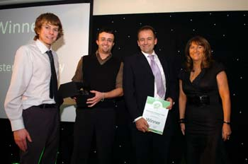 Margaret Hilton of Johnston Press presented the award to Darren Axe, Mark Taylor and Jonathan Mills of Lancaster University