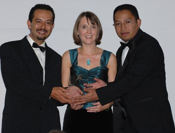 Tsiry Wilkinson (left) and Dina Rajaona (right) receive the Start Up Business of the Year Award from Gillian Bardin