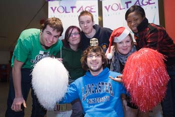 One of the student teams use pom poms to create Santa's Grotto